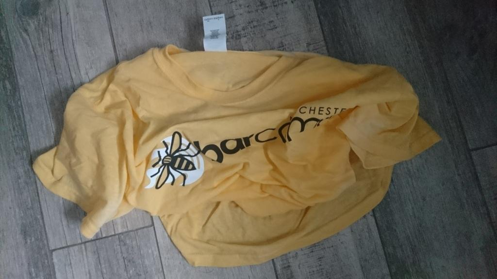 A crumpled, soggy yellow Barcamp shirt on my bathroom floor